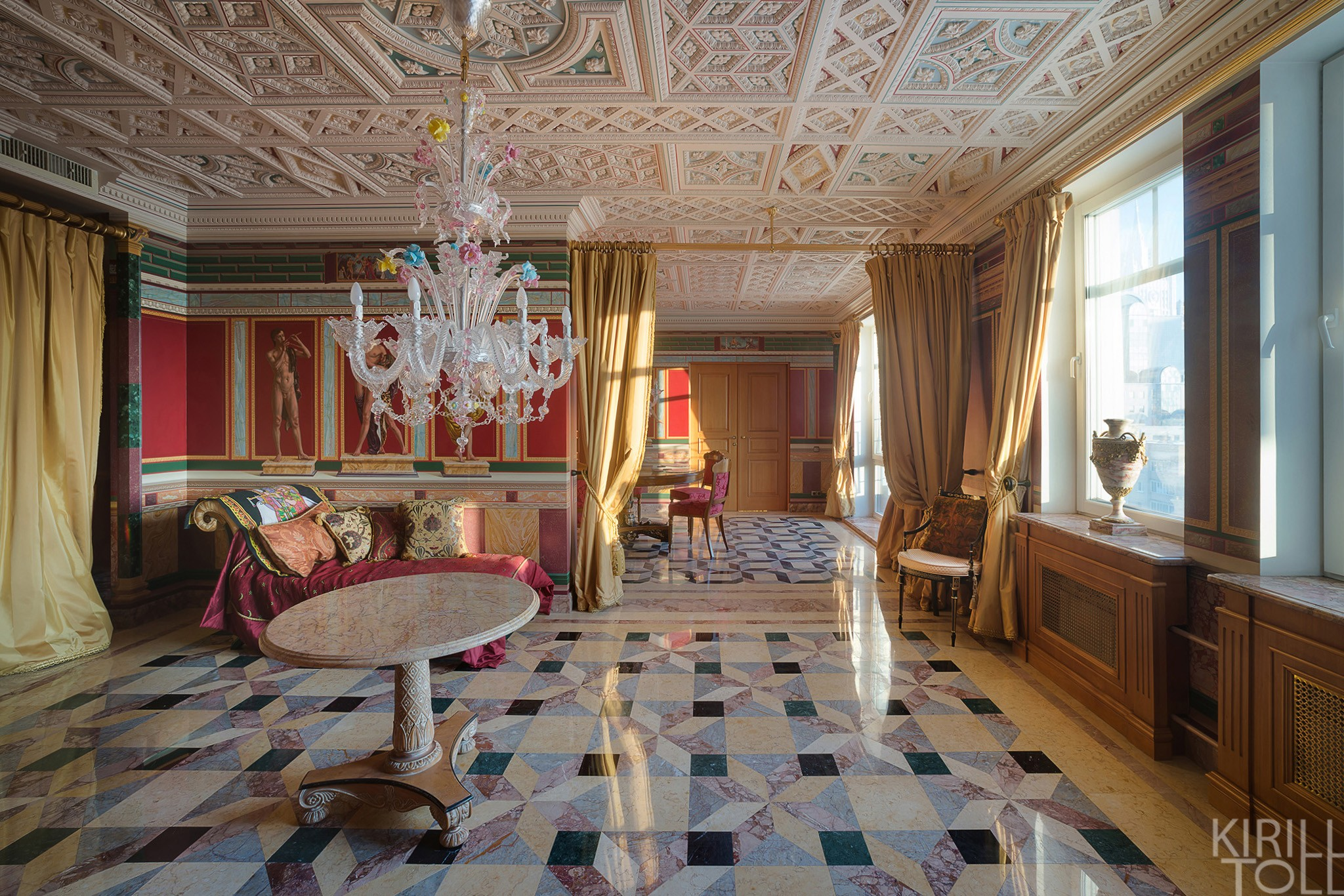 Red interior living room in roman style (or greek). Services of a photographer of apartments in Moscow