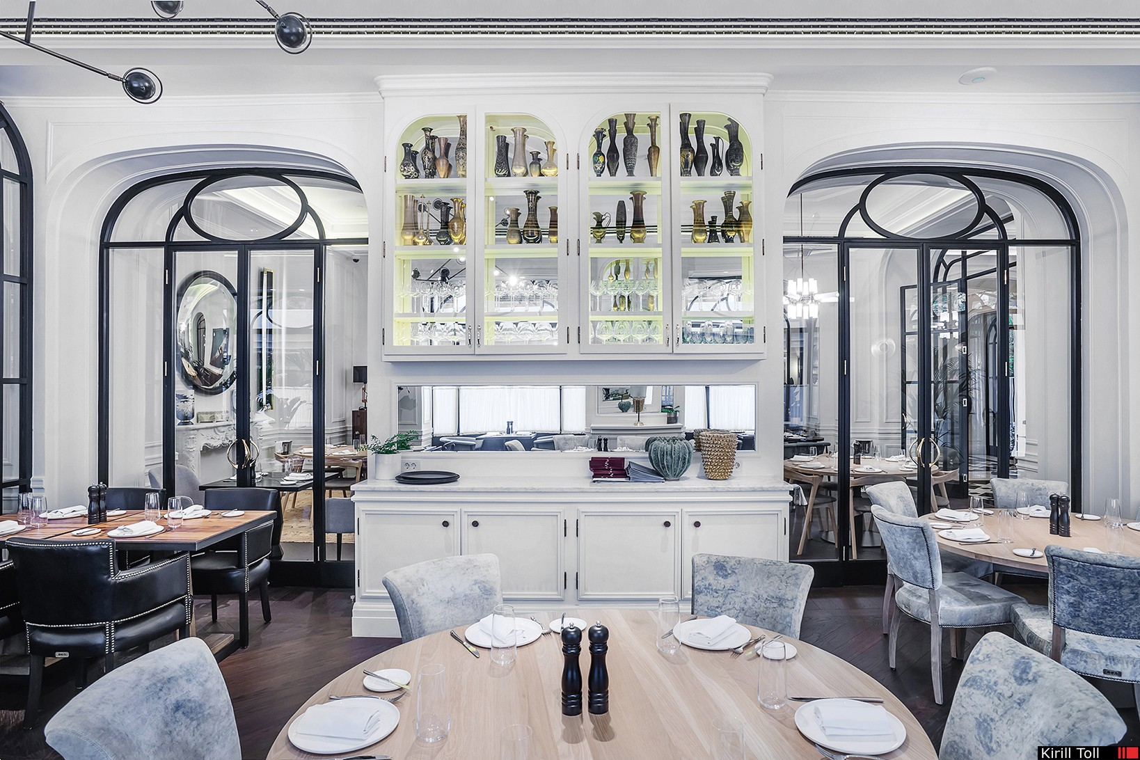 Bright restaurant in interior photos. Real estate in the portfolio of professional photographer Kirill Toll