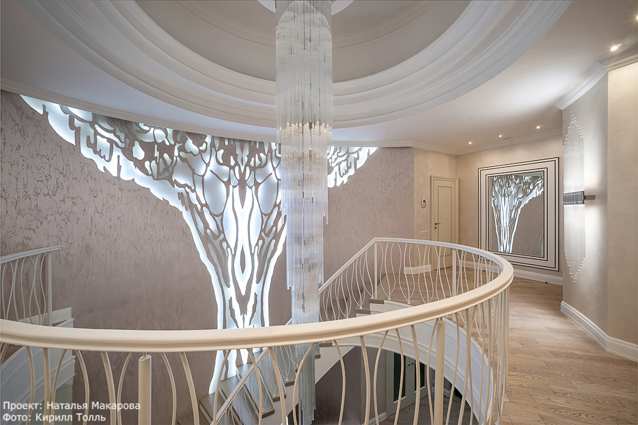 House with a large staircase and a glowing tree in interior photos